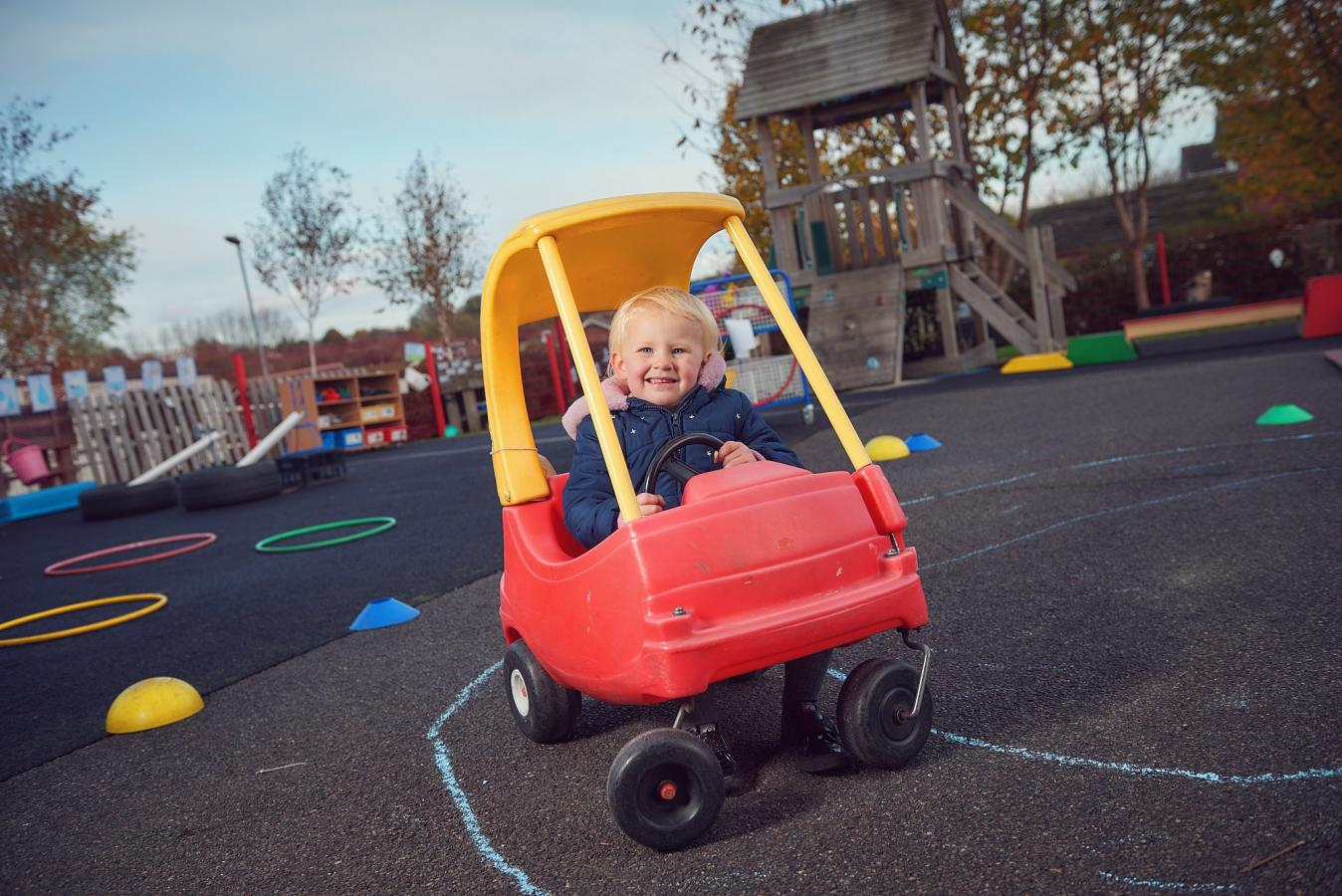 Towngate pupil in a toy car